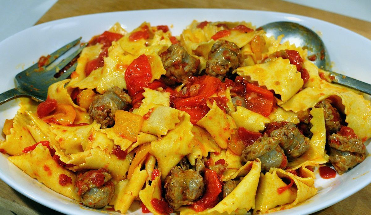 "A recipe from Marcella Hazan:  homemade pappardelle with Italian sausages & peppers...fabulous!  Recipe is in her ""Essentials"" cookbook!"