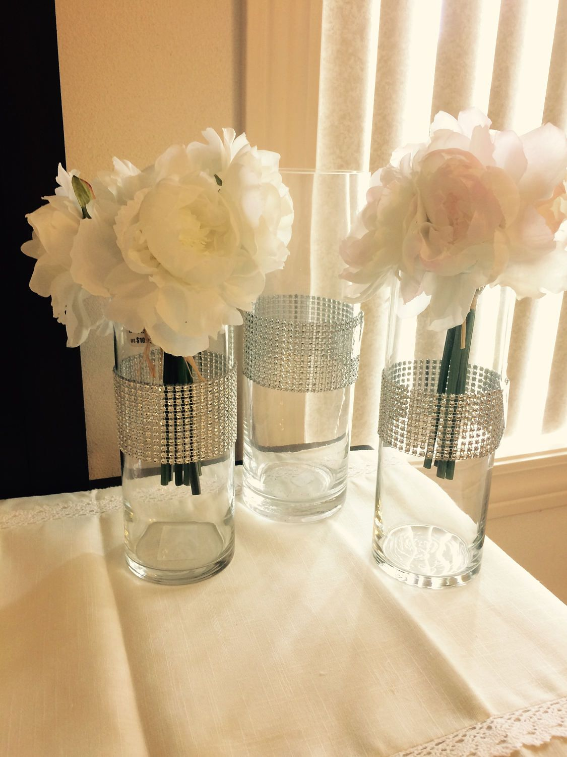 Tall wedding centerpieces cylinder shaped vases with silver tall wedding centerpieces cylinder shaped vases with silver shimmering rhinestone look mesh ribbon wrapped around the center of each vase floridaeventfo Image collections