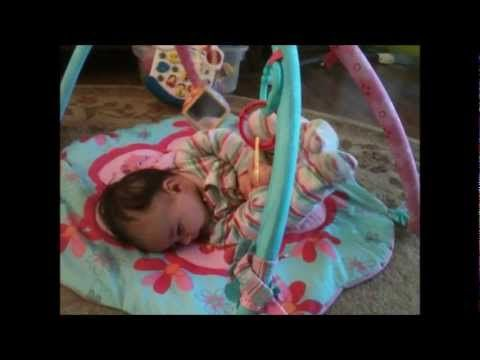 Baby girl is 4 months old and almost rolling over! - The ...