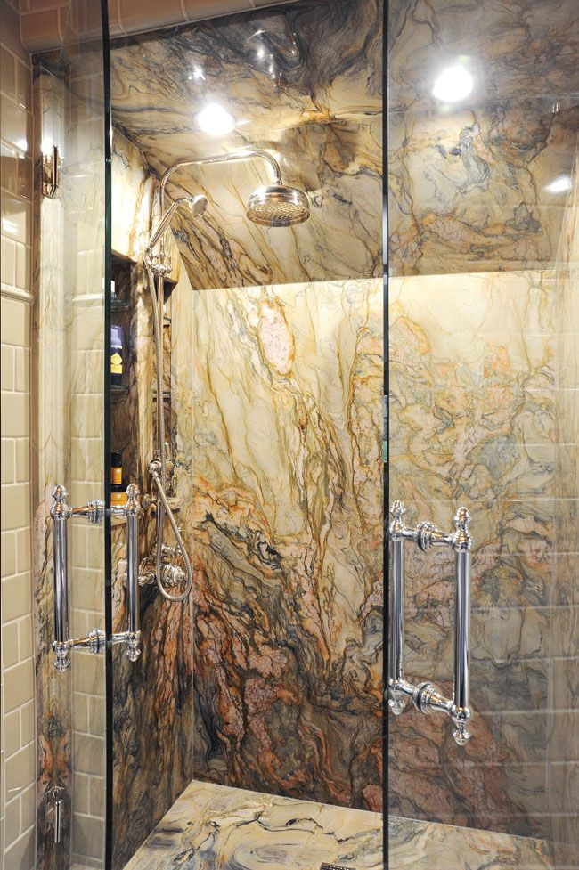 This Shower Remodel Showcases A Handpicked Slab Of Italian Granite On The Walls