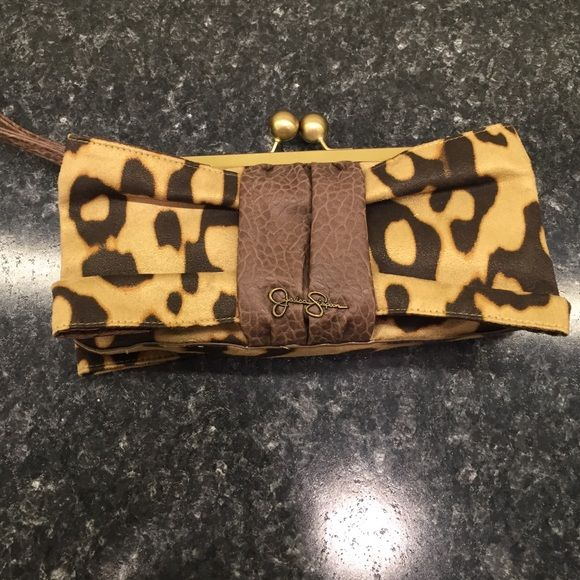 Adorable Jessica Simpson Clutch Cute cheetah print with brown and gold hardware. Little ID and CC holder comes with it that can attach to the inside by button. Very pretty and useful! #0104 Jessica Simpson Bags Clutches & Wristlets