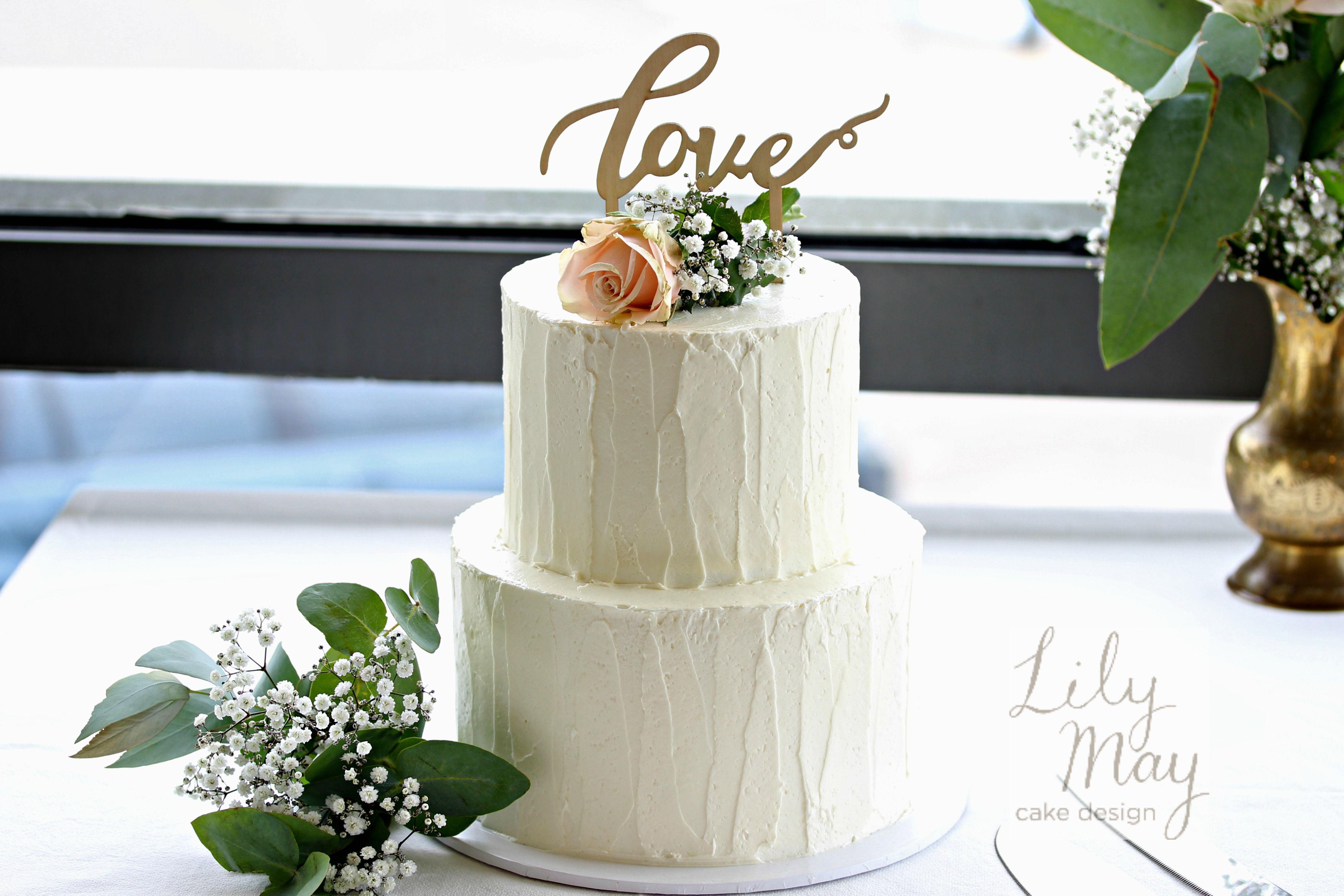 Rustic finished two tier wedding cake chocolate mud u coconut