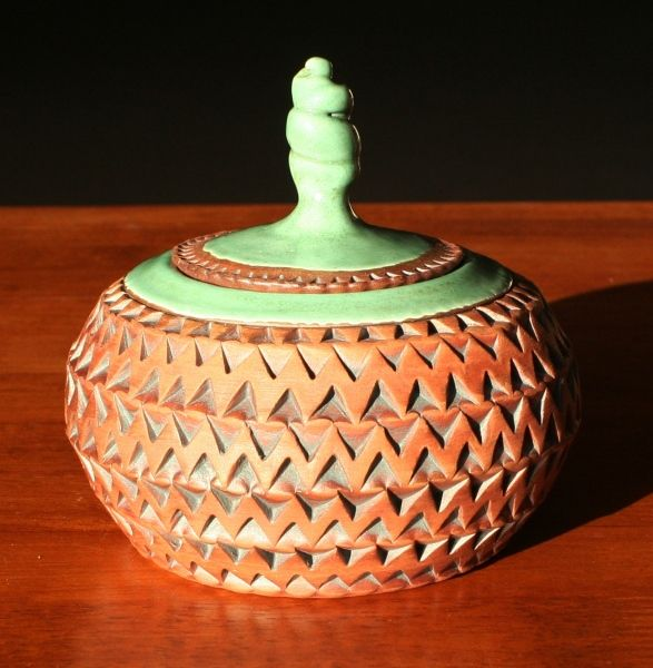 Art deco green on red clay
