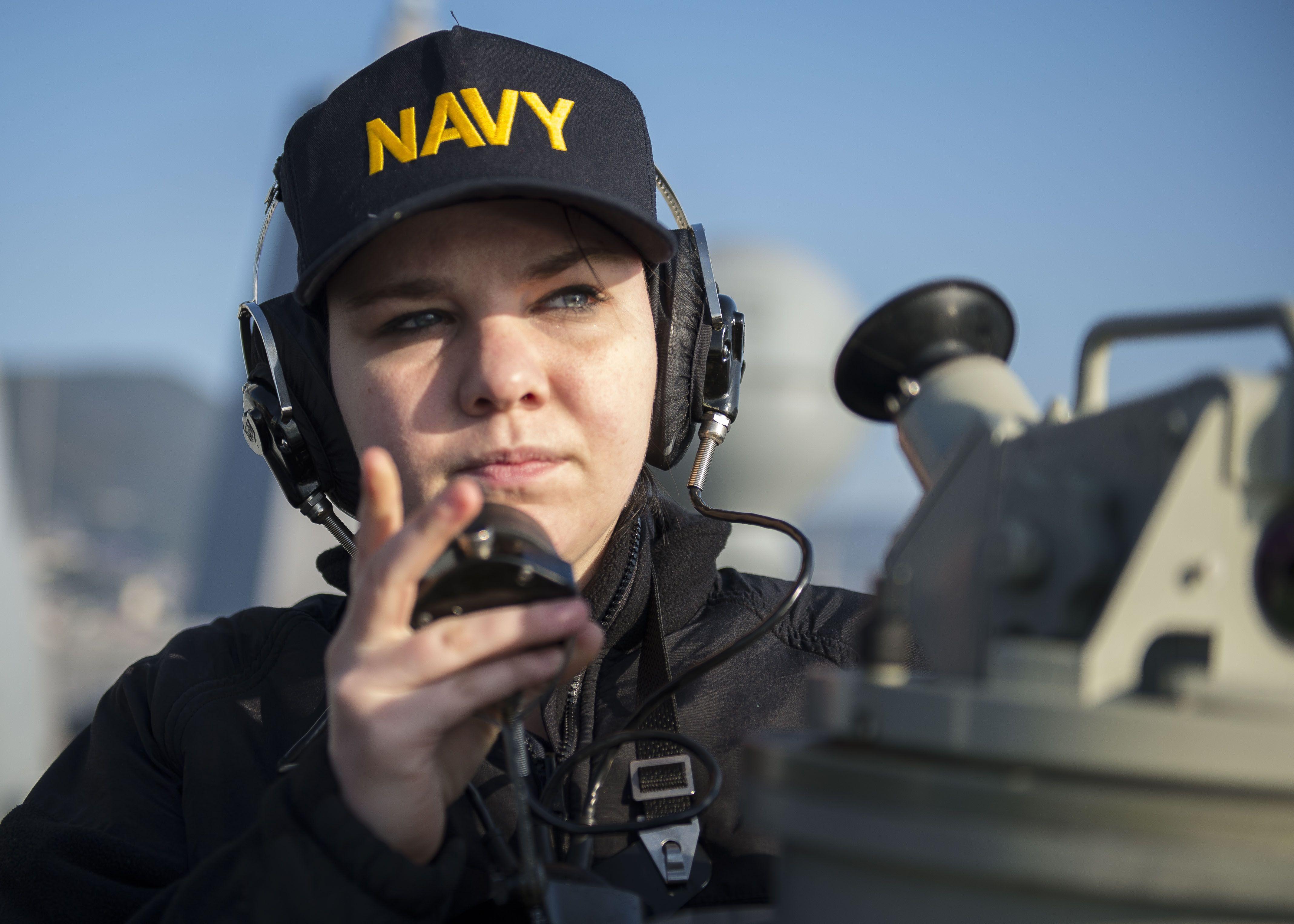 quartermaster seaman savannah williams relays bearings aboard the amphibious transport dock ship uss green bay