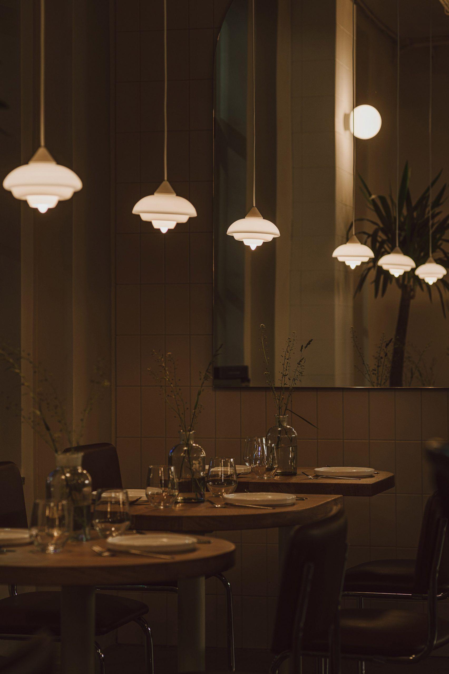 Nadzieja Restaurant In Poznan Features Understated Bauhaus Style Interiors In 2020 Lighting Design Interior Restaurant Lighting Design Bauhaus Style