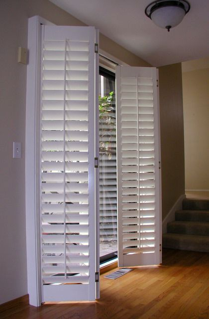 Plantation shutters for sliding door accordion plantation shutters fold em 39 as you for Bifold interior window shutters