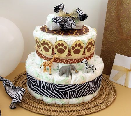 Lion King–Themed Diaper Cake. Create a two-tiered diaper cake with 100 HUGGIES® Little Snugglers Diapers and embellish with giraffe spots, zebra stripes and baby lion paw prints.