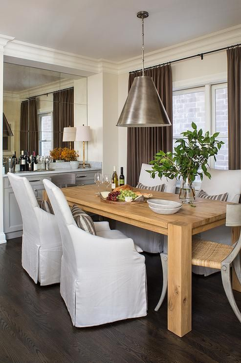 chic dining room features a crate & barrel big sur natural dining