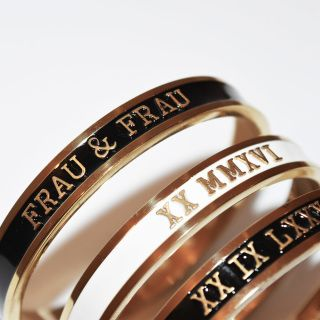 THESE STATEMENT GOLD OR SILVER PLATED BANGLES ARE HAND-FILLED WITH BLACK, CREAM,  MINT OR GREY GLOSSY ENAMEL AND HANDMADE IN LONDON WITH YOUR DESIRED MESSAGE.  FOR EXTRA INNER ENGRAVING, PLEASE CLICK HERE.