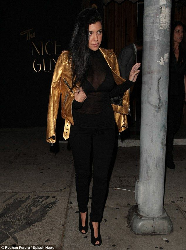 f8fc6f3d871de Stunner  She also sported black skinny trousers and heels along with a  shiny gold leather biker jacket