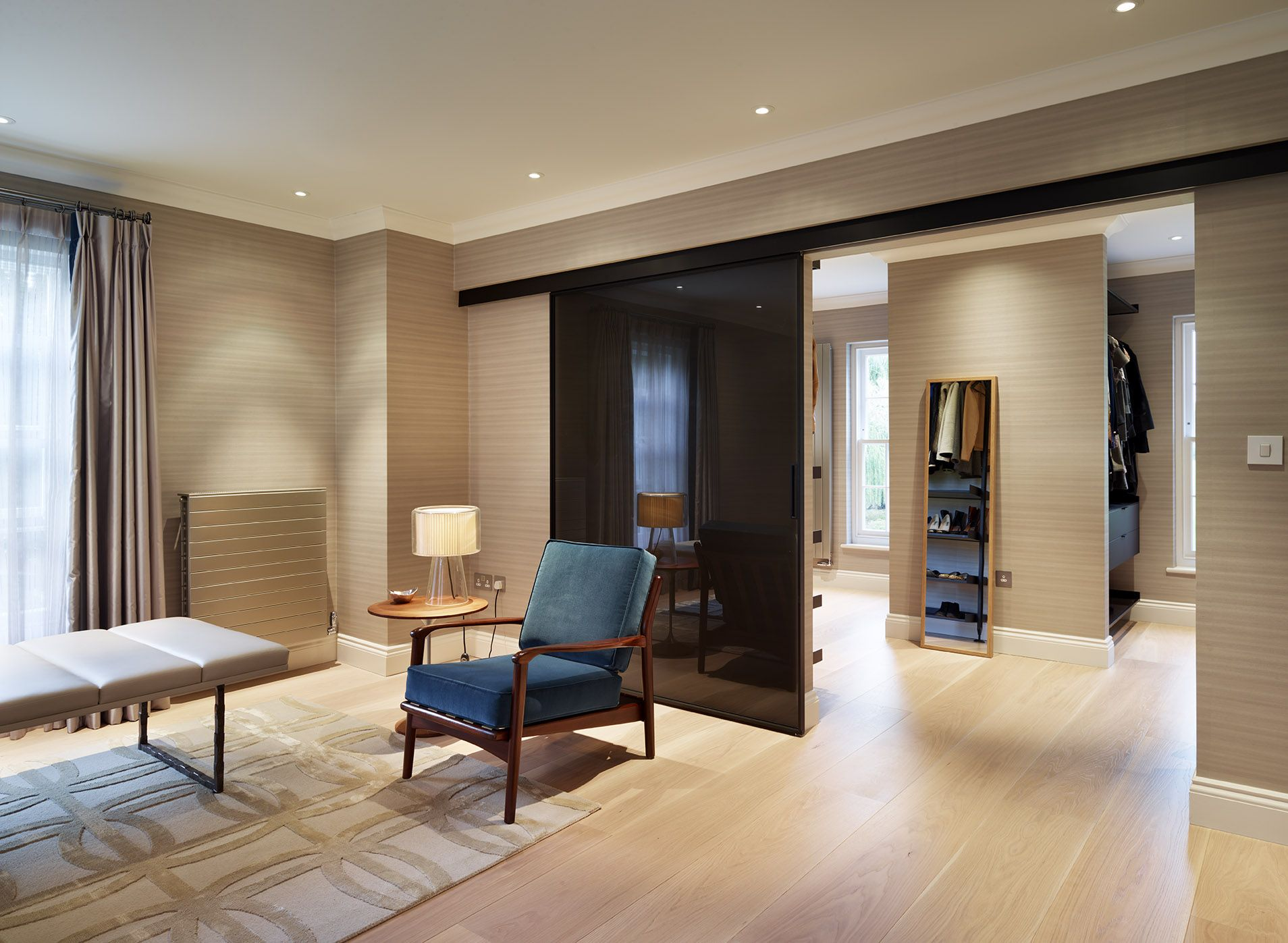 Case study rimadesio doors designed and installed in a for Master bedroom dressing room ideas