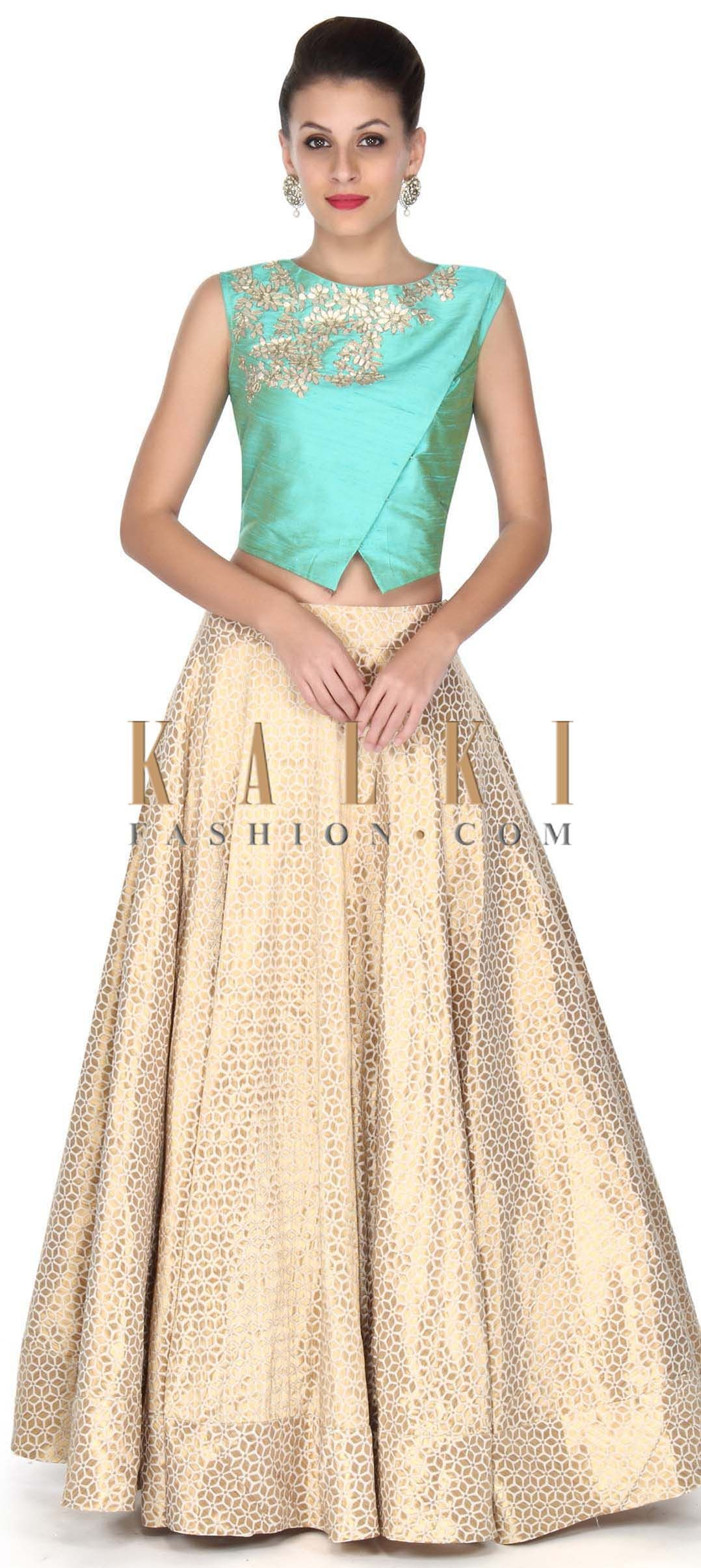 Buy this beige lehenga with blue blouse in zari embroidery only on