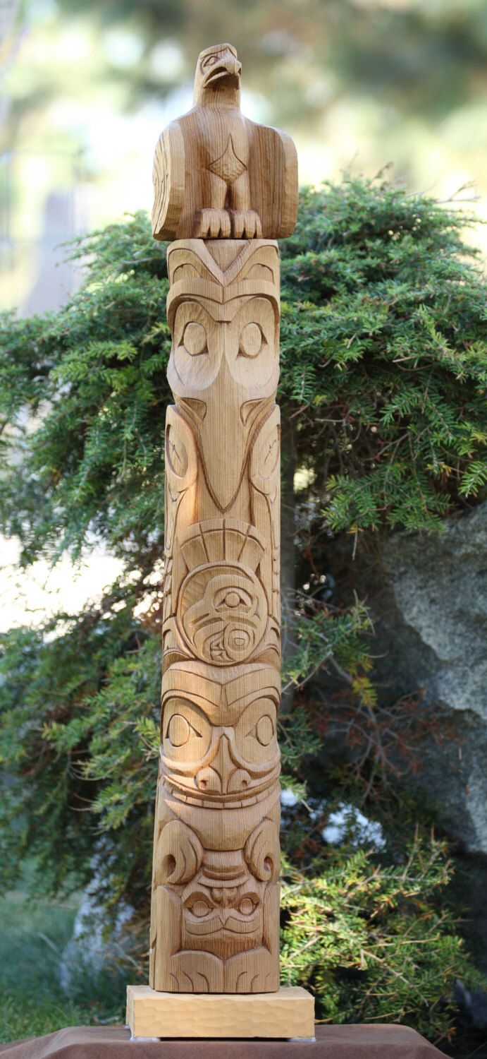 Hand carved native american totem pole woodcarving