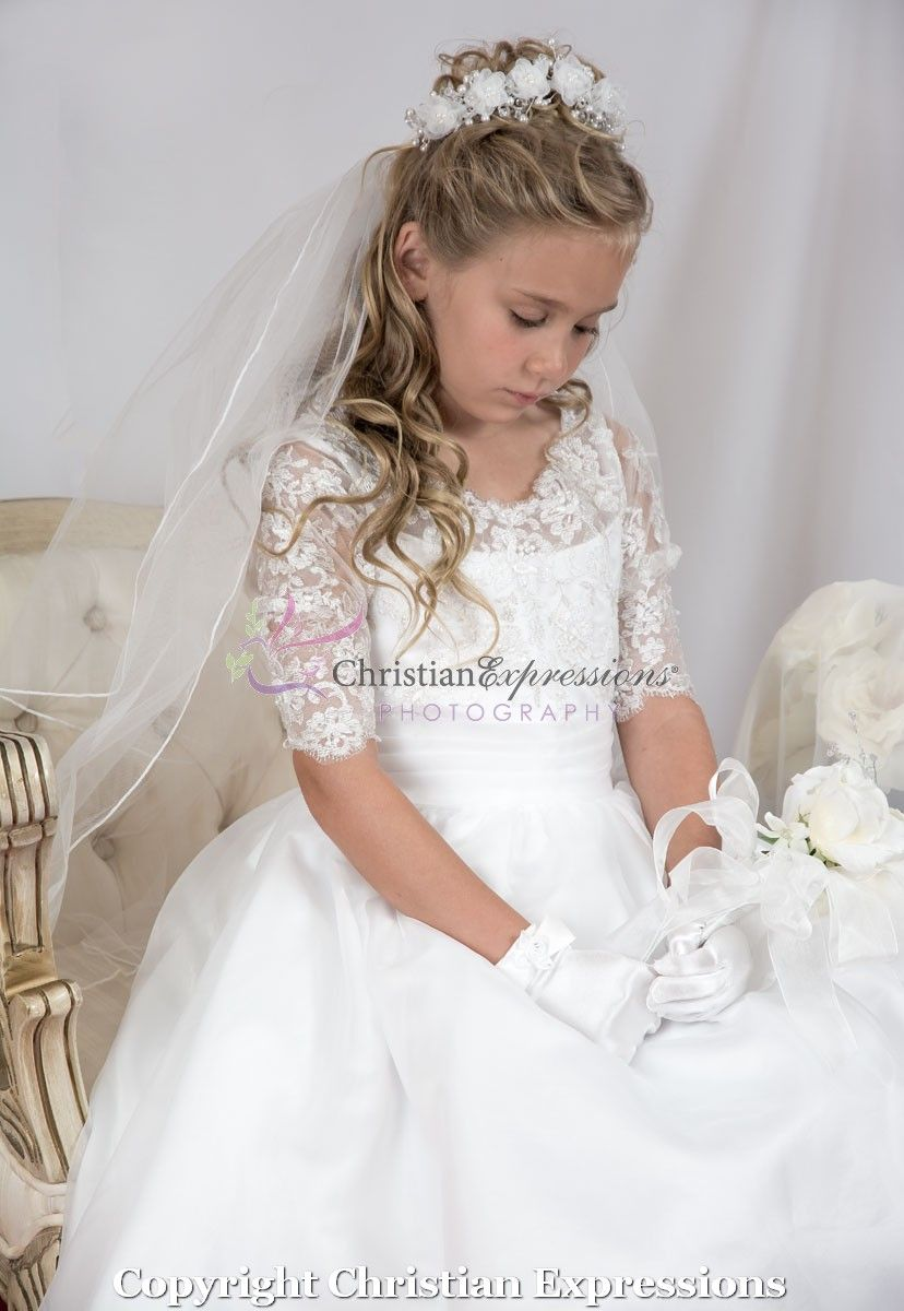 16b63c548b3 ... length first communion dress features a lace bodice with gold metallic  threading
