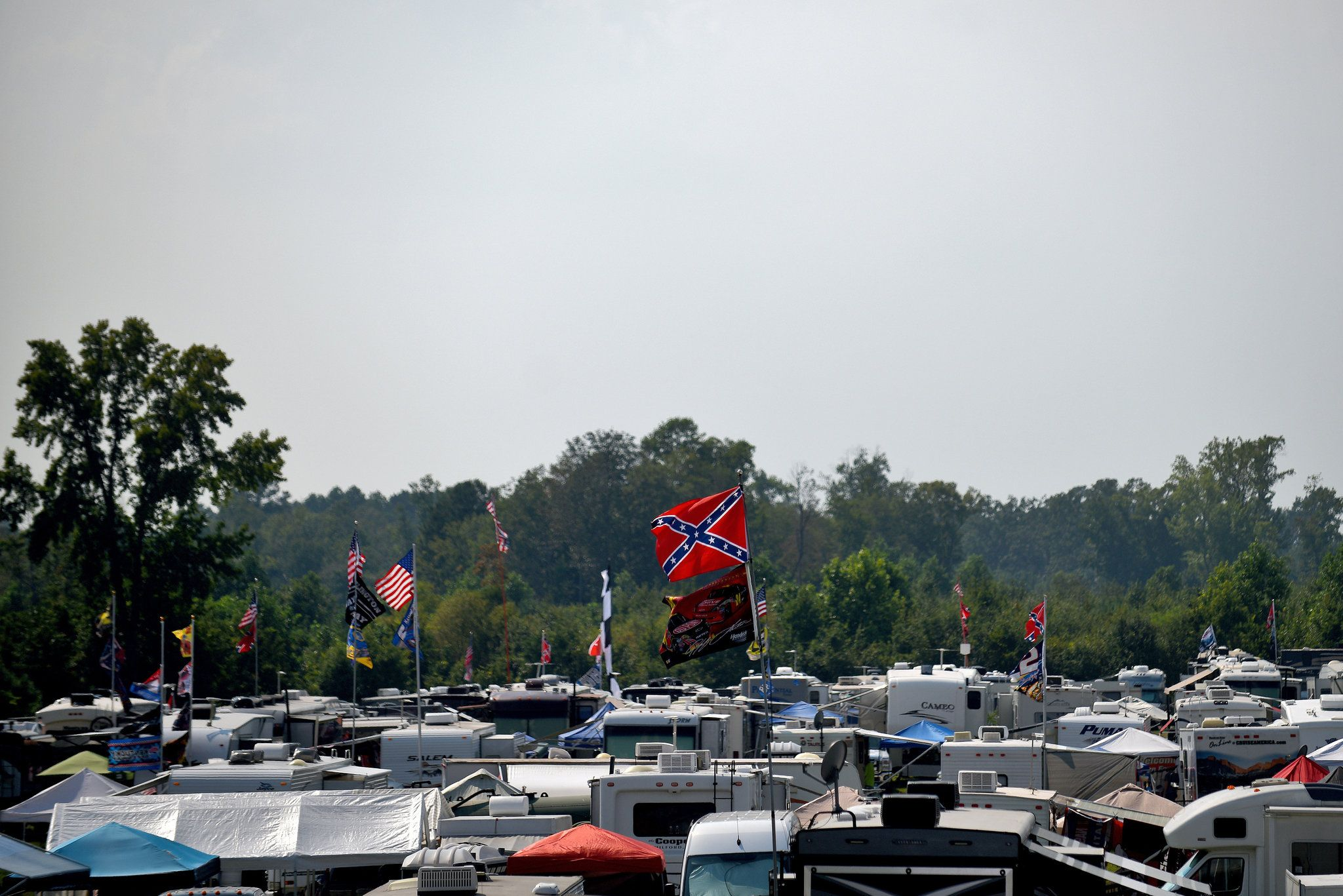 American and Confederate flags flying over the infield at Darlington Raceway, where the Southern 500... - Jonathan Moore/Getty Images