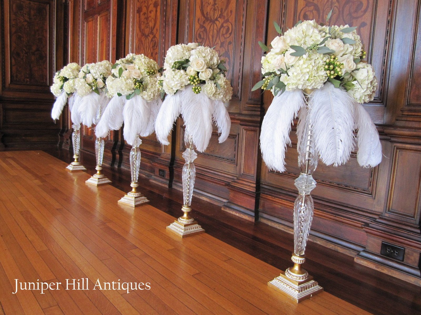 Tall table arrangements waiting to be placed on tables
