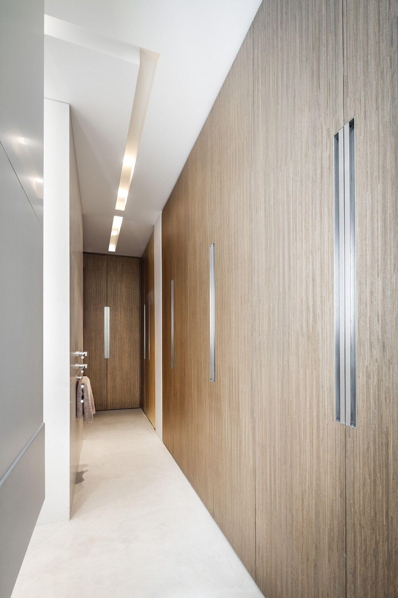 PAX white wardrobe with STOCKHOLM walnut veneer doors and URSHULT