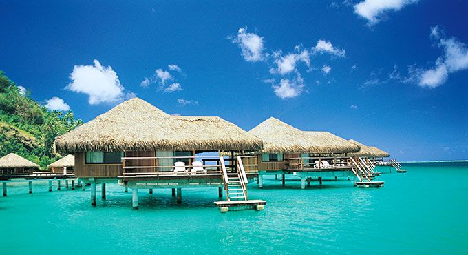 Overwater bungalows at the Te Tiare Beach Resort in French Polynesia.