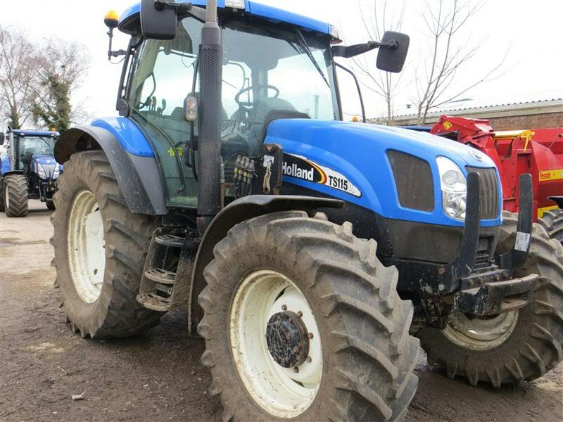 New Holland TS115A with Quicke Loader brackets  From C&O