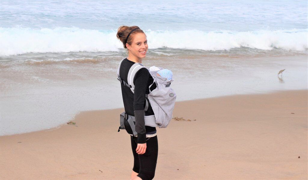 Young Mom Carrying Twins In Weego Twin Baby Carrier On The Beach