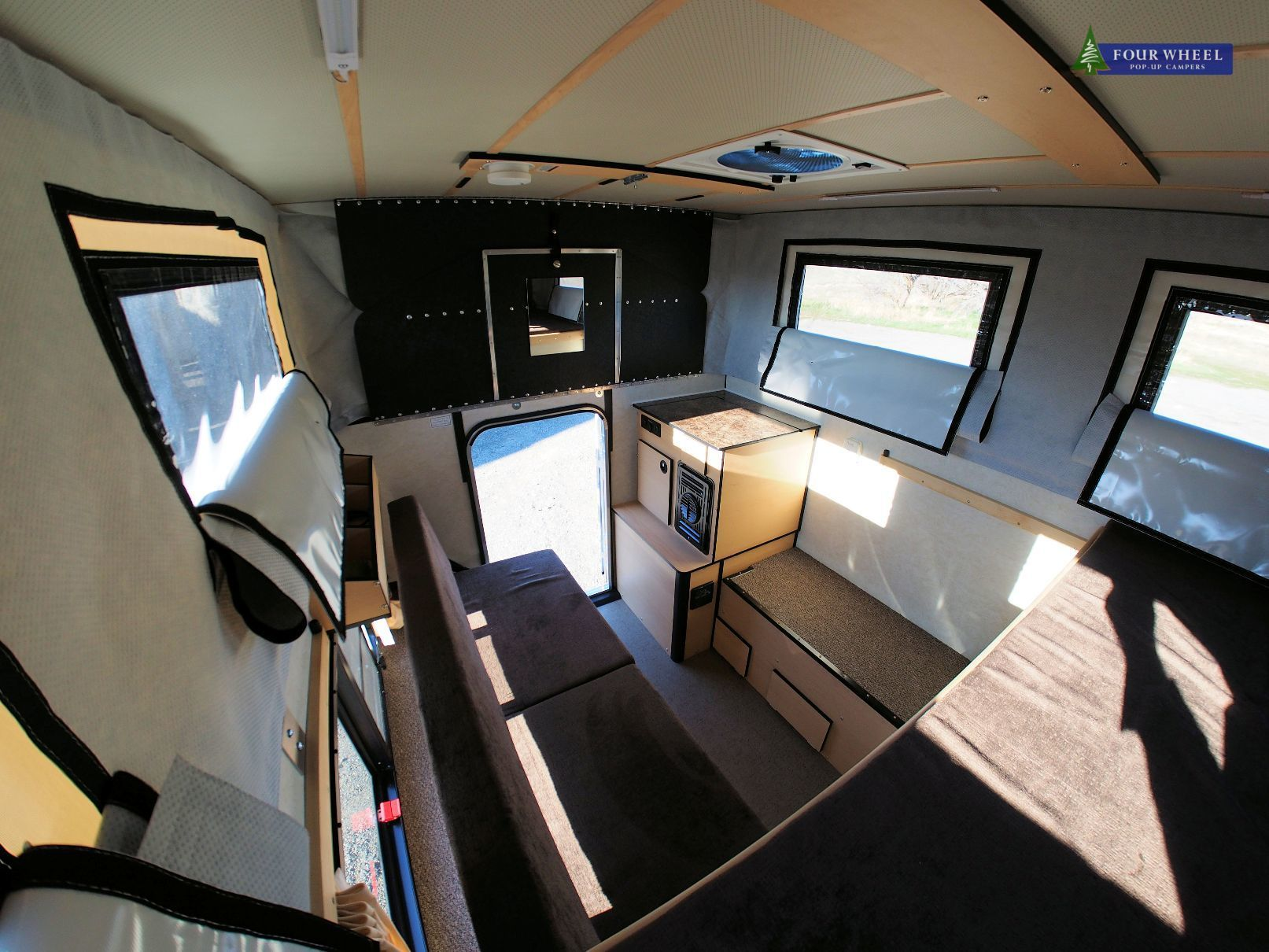 Shell #fourwheelcampers with a Rollover Couch and Furnace & thermal