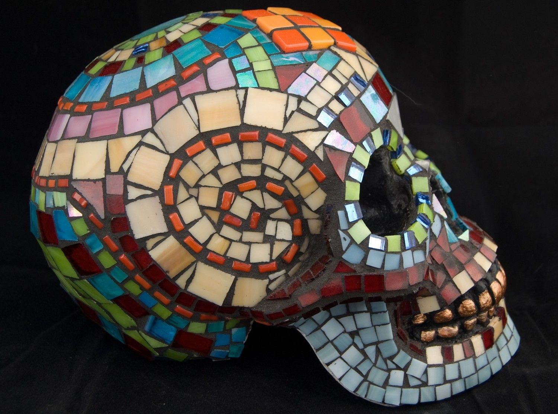 Dia de los Muertos Skull:  life-size plaster human skull encrusted in glass mosaic tiles
