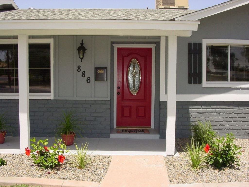 Red Door Grey House grey house, dark grey brick, red door, black house numbers, white