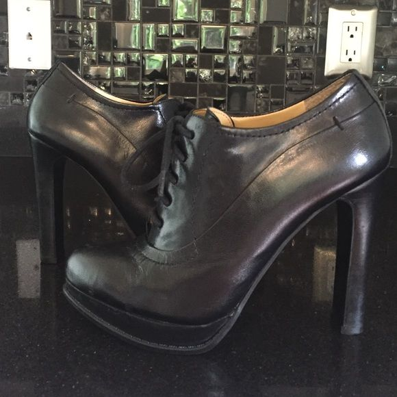 "NINE WEST ""SIZZLE"" OXFORD BOOTIE BLACK SZ 5.5 NINE WEST ""SIZZLE"" OXFORD BOOTIE BLACK SZ 5.5.  PRE-OWNED IN GOOD CONDITION. A COUPLE OF IMPERFECTIONS ON THE TOE OF THE SHOE Nine West Shoes Heels"