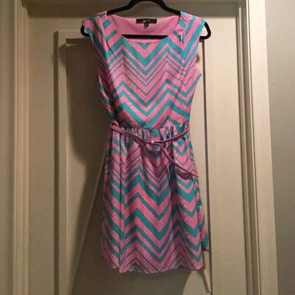 Chevron Dress with belt Super cute Julia brand dress purchased at an upscale boutique. Worn once to a shower and in like new condition. The dress is pink and teal chevron and has a matching pink belt with gold clasp. Cute with a denim jacket and booties for cooler nights or sandals for a summer day. Julia Dresses Mini