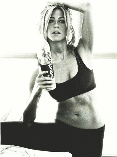 Jennifer Aniston shows off her taut, lean abs in a sexy ad for SmartWater.