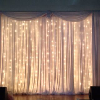 Pipe and drape with twinkle light curtains. Beautiful behind Sweetheart table. Event ideas ...