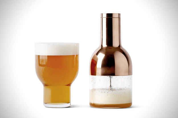 Drinking beer from a bottle at home will never be the same as getting a pint at a bar… unless you have this beer foamer.