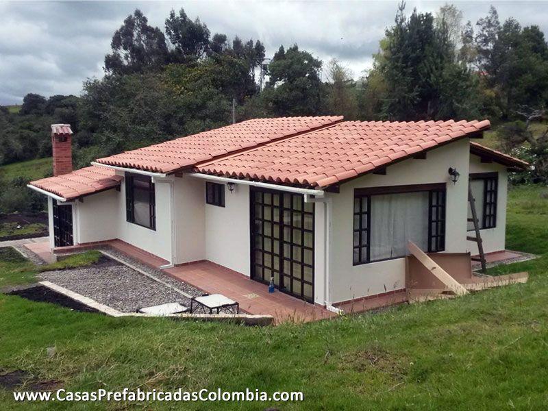 Parte posterior de casa dise ada en desnivel peque a zona - Casas rurales prefabricadas ...