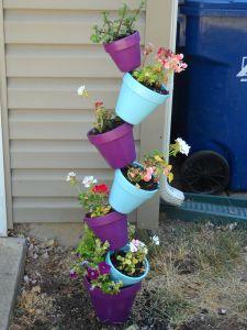 Making A Vertical Flower Pot Vertical Herb Gardens Flower Pots Flower Pot Tower