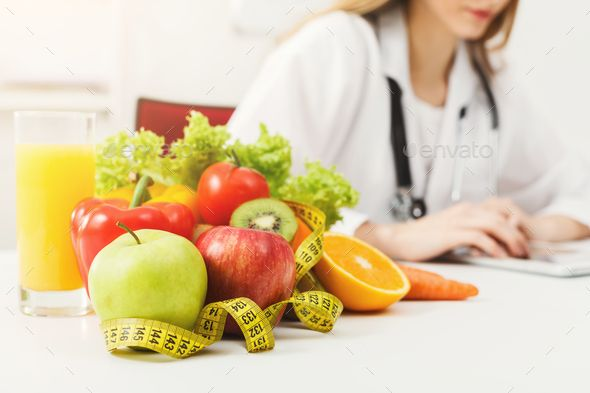 Enjoyable Nutritionist Desk With Fruit And Measuring Tape By Prostock Download Free Architecture Designs Scobabritishbridgeorg