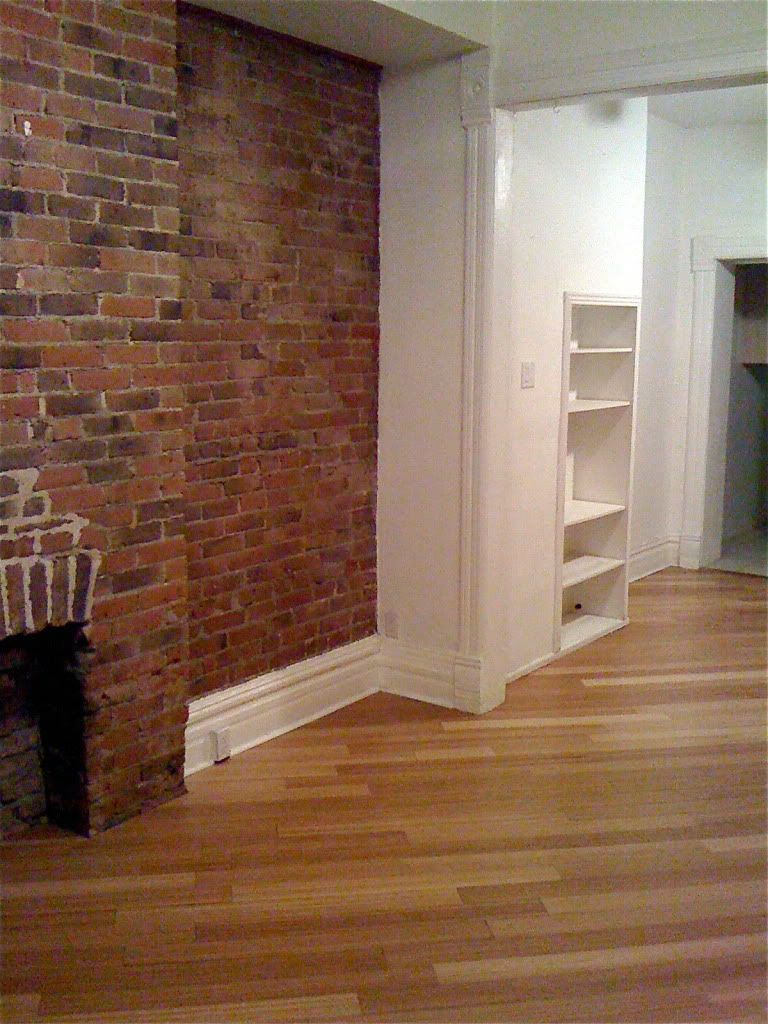 living room, exposed brick, bamboo hardwood floors photo; would