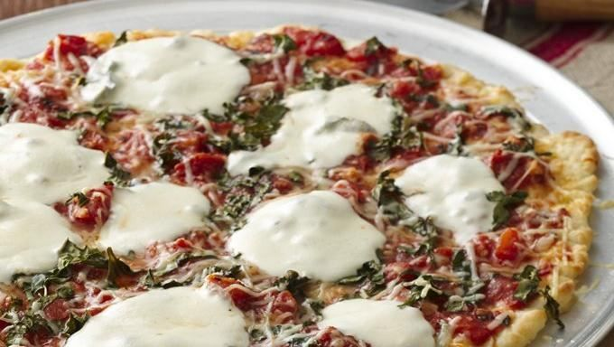 Less is more when it comes to this pizza-- simple sauce with minimal toppings.  Buon appetito!