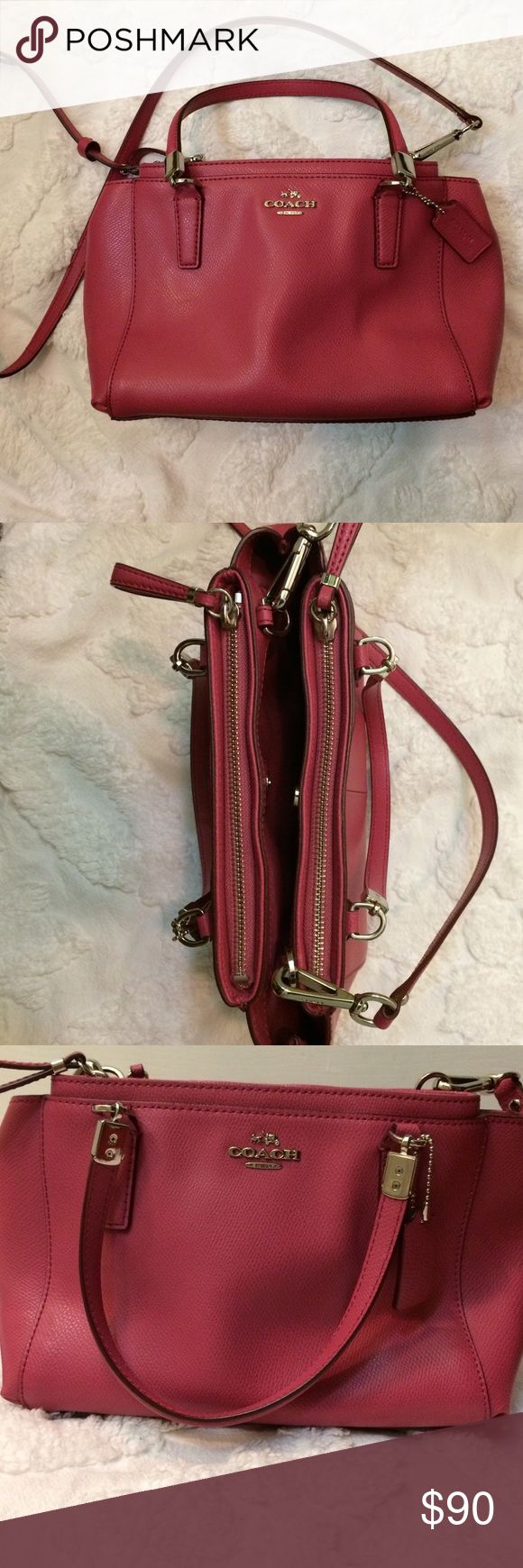 Gorgeous Coach handbag This like new handbag features two zipper compartments and a center compartment with magnetic closure. It is a pink color with two handles and longer strap for versatility. EUC this bag holds a lot! Coach Bags