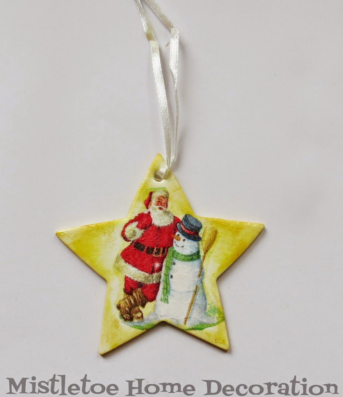 Decoupage with napkin - Christmas ornament - Santa and snowman on a yellow star