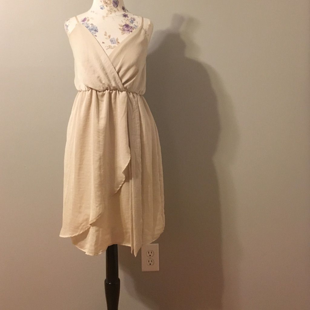 Flowy cream dress products