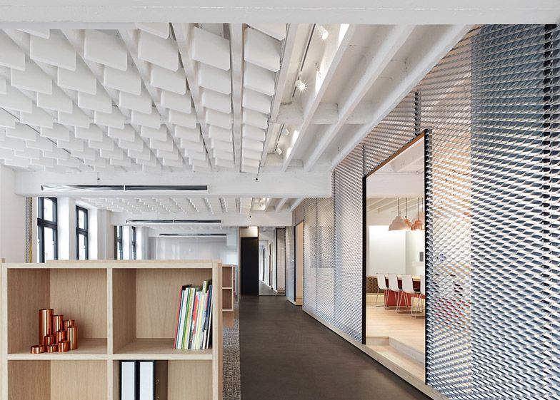 Aluminum Mesh Partitions Define Industrial-Inspired Office