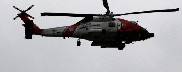 U.S. Coast Guard searches for two helicopters after reported collision. (Allison Joyce/ AFP Photo)