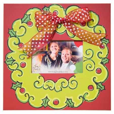 "Picture frame with a wreath motif and bow accent. Holds a 5"" x 7"" photo.  Product: Picture frameConstruction Materia..."