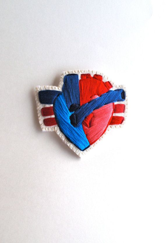 Anastridendeavor - Embroidered anatomical heart brooch with reds and blue on cream muslin with cream felt backing
