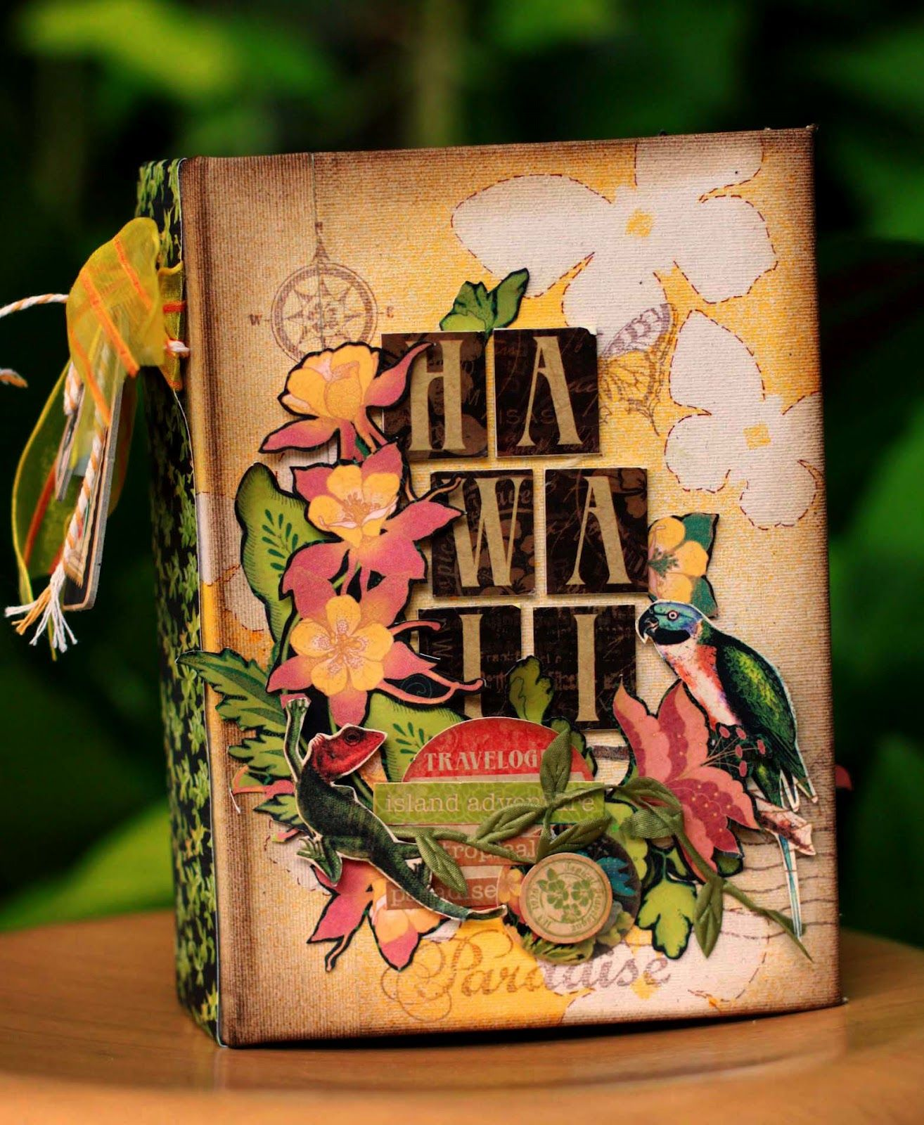This awesome altered book is by @Sharon Ngoo to remember her honeymoon. She used the Tropical Travelogue collection and May Arts Ribbon. Wow! What a cool idea!! #graphic45 #mayarts
