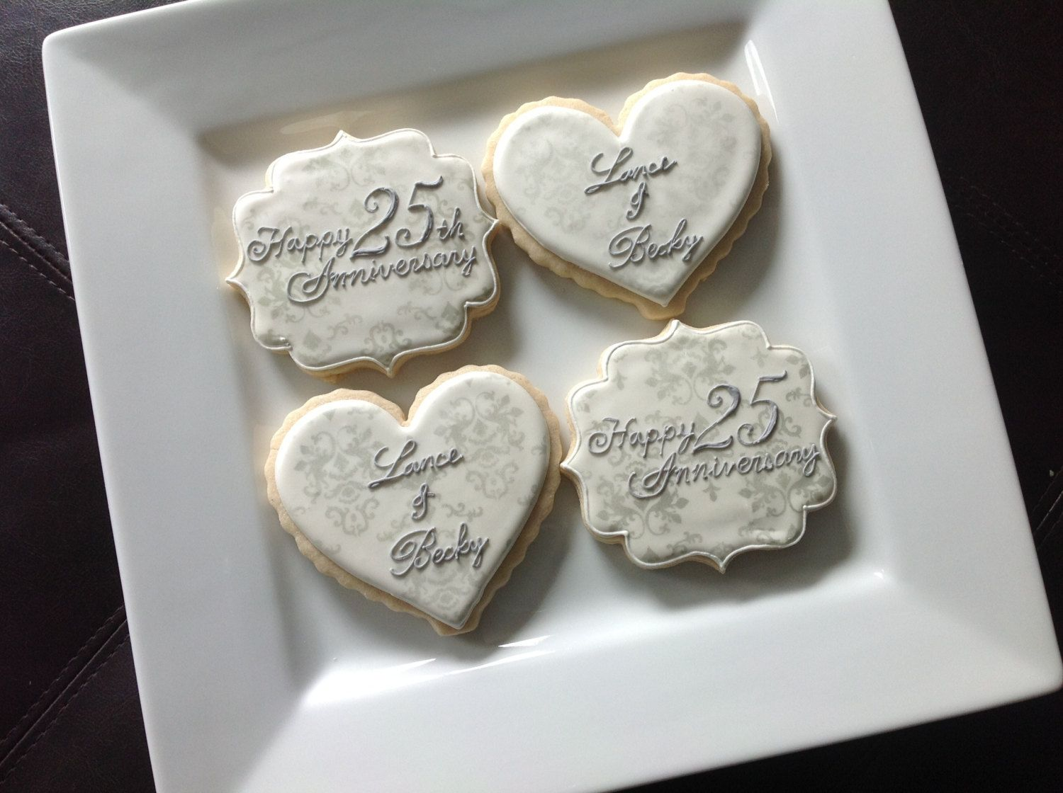 Dozen silver th anniversary cookies by