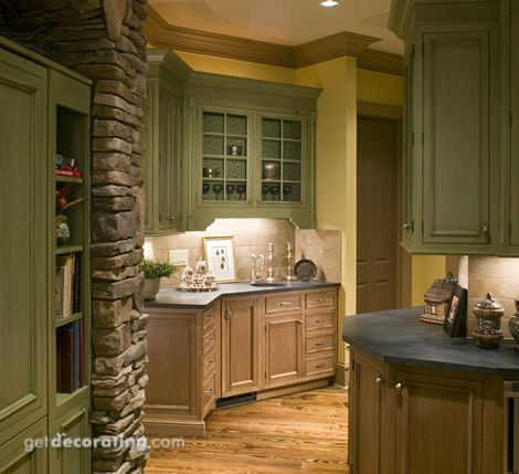 Soft tobacco green cabinets with shelves installed in front of ...