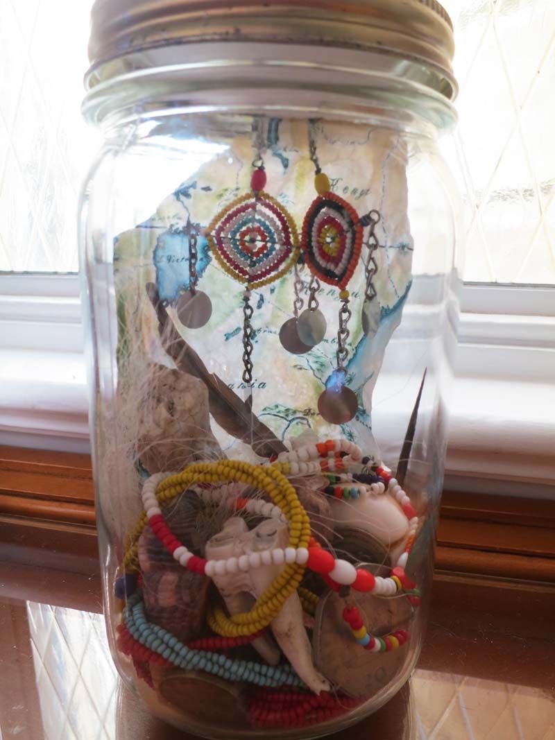 Gather bits and bobs from your travels and assemble them into a mason jar as a perfect holiday memory keeper!