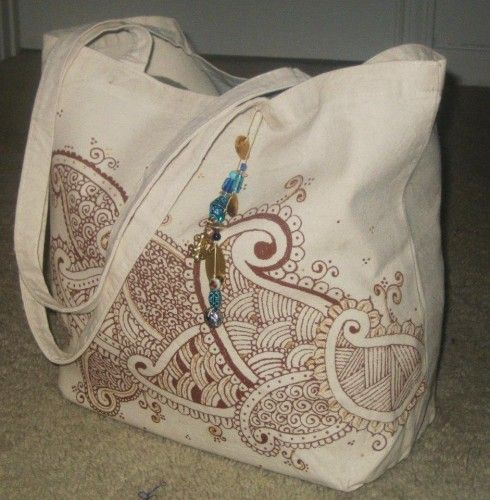 {What a fabulous idea!!! Use colorful sharpies to draw a Henna Desgin on a canvas bag!}