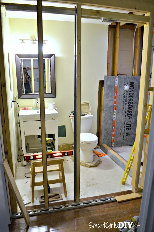 Installing Split Jambs For Pocket Doors By Smart Girls Diy In 2020 Diy Shower Pan Pocket Doors Pocket Doors Bathroom